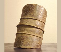 Large, heavy, copper alloy leg bands were used as a form of currency for important transactions, including purchasing a bride!  These currencies were sand-cast in the earth and while the metal was still malleable, they were wrapped over a log to make the cylindrical shape. Wealthier women wore these leg bands and used rolls of plant fiber to protect their skin from rubbing.