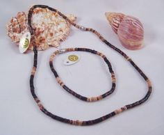 """One New Necklace & Anklet Heishi Puka Shell Set #S1060  This is a gorgeous 2 piece Heishi puka shell set featuring an 18"""" necklace and matching 9"""" anklet.Both have screw on barel clasps. Very High quality set made in The Phillipines.  Yes we do..."""