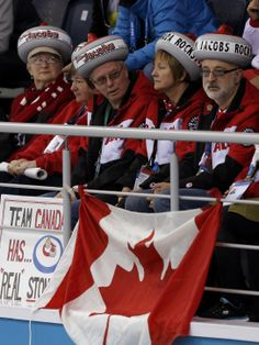 Fans of Canada attend their men's curling round robin game against Norway at the 2014 Sochi Winter Olympics in the Ice Cube Curling Center, Feb. 14, 2014.