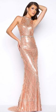 Sparkle and shine all night long in this Liquid Sequin Keyhole Open Back Beaded Evening Dress by Mac Duggal. This ultra glamorous dress includes a fully sequined column silhouette with an elegant sweep train and a sexy keyhole open back. This style is adorned with high end gorgeous beading that cascades down the body and a fully rhinestone embellished waistband. #edressme