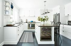 With ample storage, room to circulate and a [Vintec](wine fridge built into the island bench, the generous kitchen is an entertainer's dream. **Joinery** by[Endeavour Joinery]( Kitchen On A Budget, New Kitchen, Kitchen Decor, Crisp Kitchen, Kitchen Rug, Beautiful Kitchen Designs, Beautiful Kitchens, Black Kitchens, Home Kitchens