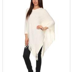 Knit poncho White Knit poncho with fringes. 100% acrylic.     NB5 Jackets & Coats