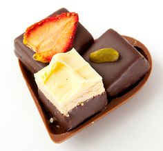 A chocolate heart with 3 delicious chocolates