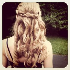 Curled hair with french braid pulled back. I used this for my graduation dance.