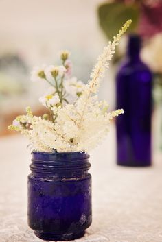 I like the idea of smaller jars with smaller flowers, tea lights in other jars too....