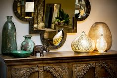 Zenza lamps and a bone mirror made from Le Patio.
