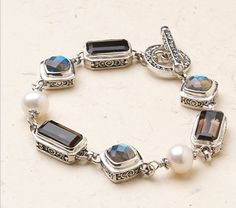 """Bali Scroll: Labradorite Treasures Bracelet - $165  Smoky quartz, pearl and cushion-cut labradorite in sterling silver with toggle closure. Fits up to a 7 1/2"""" wrist.   http://blessedtreasures.jewelry.willowhouse.com/product.aspx?zpid=6533"""