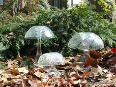 This trio of mushrooms is a whimsical touch to any garden.  For sale at Re-Creations in Glass.com