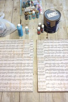 DIY Canvas Art: Like the idea of using sheet music to cover the canvas first.