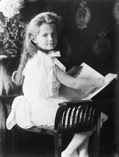 """Grand Duchess Maria Romanov reading, 1906.  Grand Duchess Maria Nikolaevna of Russia (1899–1918) was the third daughter of Tsar Nicholas II of Russia and Tsarina Alexandra Fyodorovna.  Tatiana Botkina thought the expression in Maria's eyes was """"soft and gentle."""" As an infant and toddler, her physical appearance was compared to one of Botticelli's angels. Grand Duke Vladimir Alexandrovich of Russia nicknamed her """"The Amiable Baby"""" because of her good nature."""