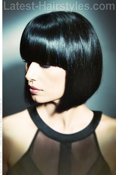 Sleek Geometric Bob Haircut would like this if it was lighter brown coulor