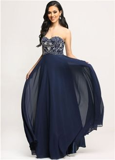 Strapless prom gown that features a beaded bodice