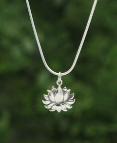Detailed sterling silver charm pendant shows the lotus flower in full bloom to signify hope and triumph. Made of sterling silver.