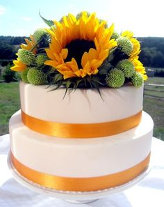 This is almost EXACTLY what I want for my cake, Except brown ribbon and just a few sunflowers by themselves. LOVE IT
