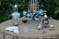 the rusticity of  burlap mixed with the elegance of silver plate! Silver Plated Teapot Sets, Silver Plated and Glass Caraffes, Metal centerpieces, Glass Teacup & Sandwich Platters. All for rent @ The Tea Party Company