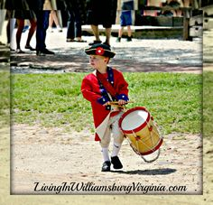 The Little Drummer- Colonial Williamsburg, Virginia. This little drummer was ready for action at the recent Drummer's Call event in Colonial Williamsburg. His dad gave us permission to take his photo as he watched the performers, anxious to be old enough to participate.