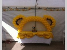 Winnie the pooh. Balloons arch and ears to decorate the table