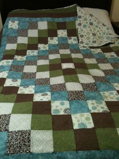 Quilt I made for friends wedding present. It says their names and wedding date in the middle.