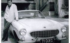 Volvo P1800, The Saint  Roger Moore at Elstree Studios with 71 DXC, one of the Volvo P1800 coupés used in The Saint TV show that's just been restored and will go on display at the Classic Vehicle Restoration Show on November 3-4 at the Royal Bath & West Show Ground, Shepton Mallet.