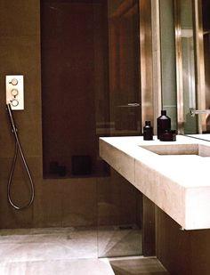 Sleek bathroom in Paris by Studio Ko with Ex Voto bath products _