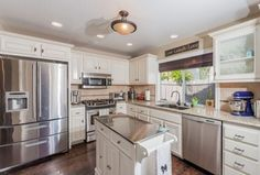 Traditional Kitchen with Simple granite counters, Kitchen island, flush light, Cuisinart TOB-40 Classic Toaster Oven