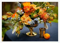vibrant orange and peach floral centerpiece-Absolutely scrumptious, and beautiful, love the color combo here!!