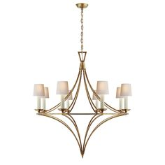 With its open, pointed framework and gilded iron finish, this stately chandelier…