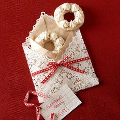 Festive Doily Envelope: A couple of bite-size Nut Ring cookies fit perfectly into a envelope crafted from a square doily, brown parchment paper, and ribbon. From Better Homes and Gardens ~ Epi