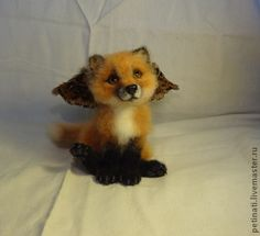 "ANNA PETINATI -- Milled fox ""Tricky Angel"" -- Pup is made of merino wool, eyes raspisany in hand, the wings of pheasanta feathers, claws and nose.  Handmade."