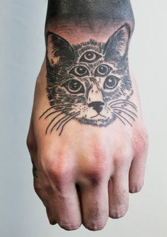 Black cat tattoo - it looks so poorly done. I feel bad for the cat!