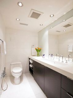 The guest bathroom is fitted with custom vanities and cabinetry, a hand-held bidet and Thassos white marble on the walls and floors.
