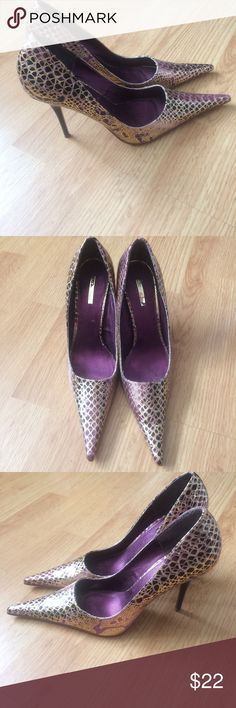 Purple and gold Michael Antonio Pointed Toe Heels Excellent condition purple and gold. Can't find the size but pretty sure. They are a 7. Michael Antonio Shoes Heels