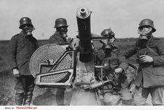 German soldiers, wearing gas-masks, manning a Maxim Flak M14 light anti-aircraft gun, ca.1915-18