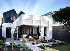 Box-like rear exterior of the Auckland home inspired by shipping container design