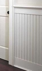 beadboard? Looks more formal with wide baseboard and ledge
