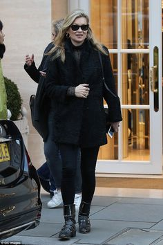 Simply stylish:The Croydon-born star looked typically chic, rocking a black textured pea coat which she teamed with her revered black skinnies