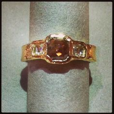 Textured 14k yellow gold band with 1.20ct brownish center rose cut diamond and .25ctw white side rose cut diamonds by Just Jules.  At DVVS Fine Jewelry