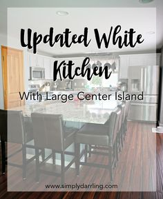 An unexpected home disaster turned into an amazing kitchen remodel. This white kitchen has the most amazing large center island! Check out the before/after images, and some tips on the favorite products used.