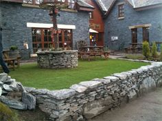 The artificial grass really complements the old brickwork of this pub.