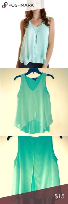 Split-back split-front top Great lightweight layered tank shirt. top layer is shear so it has a great airy lightweight feel and flow. Color is pastel/seafoam green. Necklace included Iz Byer Tops Tank Tops