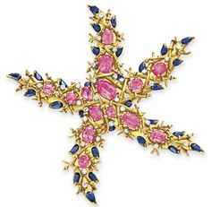 A TOURMALINE, SAPPHIRE AND DIAMOND STARFISH BROOCH, BY JEAN SCHLUMBERGER  Designed as a sculpted gold starfish, set with oval-cut pink tourmalines with circular-cut diamond detail and pear-shaped sapphire trim, mounted in gold and platinum, circa 1945  Signed Schlumberger for Jean Schlumberger