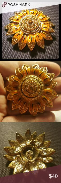 Stunning Vintage Sunflower Brooch This is one of my favorites. I love this Sunflower brooch. It is very pretty yellow and orange enamel with red and black tints. The edges and center are textured goldtone metal with orange diamond like rhinestones. Mint condition. Vintage Jewelry Brooches