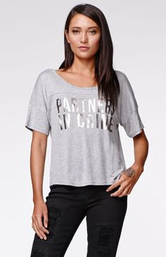 """The women'sPartners Football T-Shirt by Kendall & Kylie for PacSun and PacSun.com features a cropped cut and metallic graphic on the front. We love the super soft fabric and and slouchy fit. Wear this tee with our high waisted denim and layer with a cardigan!18"""" length3"""" sleeve lengthMeasured from a size smallModel is 5'9"""" and wearing a small100% rayonMachine washableImported"""