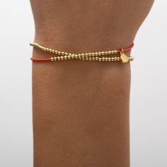 gold dipped sterling silver beads on coral silk cord. The beads are moveable on the silk thread. logo charm contains a tiny diamond. Gold Dipped, Silk Thread, Silver Beads, 18k Gold, Cord, Sterling Silver, Diamond, Bracelets, Collection