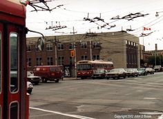 toronto trackless trolleys | ... and 4 annette trolley buses cross under a mess of trolley coach wires