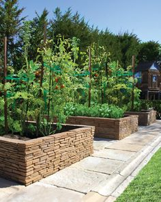 Bradstone Madoc Wall Used As A Raised Garden - mediterranean - landscape - new york - Nicolock Paving Stones and Retaining Walls