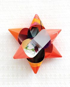Gift bows made from magazine pages. Neat! Tutorial at link.