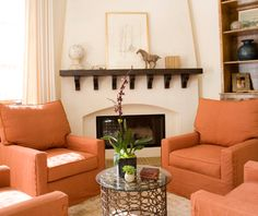 An elegant and understated living room is dramatically changed with a new fireplace.