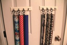 Hang your wrapping paper on hooks using curtain rings.