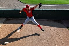 Washington Nationals starting pitcher Stephen Strasburg warms up before the first inning of a spring training baseball game